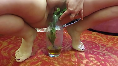 woman pissing in a vase