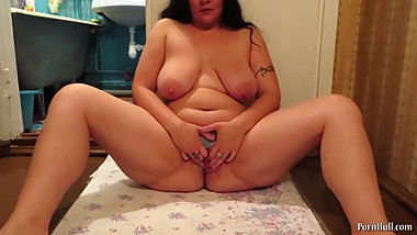 urination of a mature woman with big natural tits