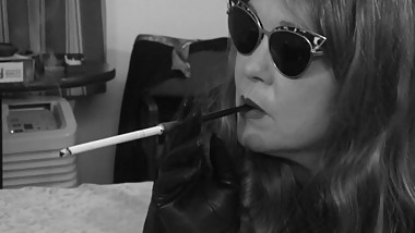 JEANIE SMOKING A VS SUPERSLIM IN A HOLDER, DRESSED IN LEATHER (B&W Version)