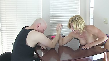 After loser gets beat in arm wrestling by a girl, he gets his balls busted