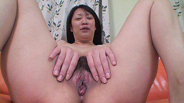 Sweet looking Japanese cougar is hiding big tits under her black outfit